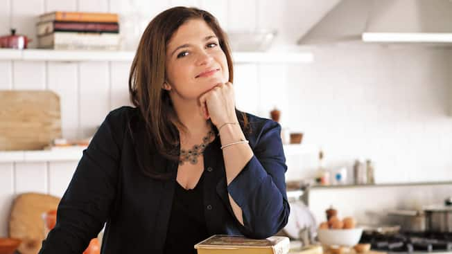 Celebrity chef Alex Guarnaschelli rests her chin on her hand