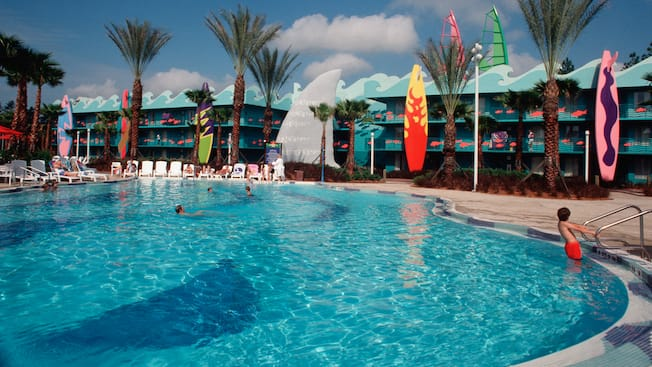 Beach-themed Surfboard Bay pool offers cool blue water and giant surfboards that stand close to it