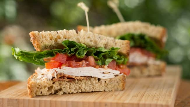 An herb-roasted turkey sandwich on seven grain bread with tomatoes, lettuce and bacon