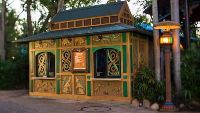 A kiosk with a menu and a sign that reads The Smiling Crocodile