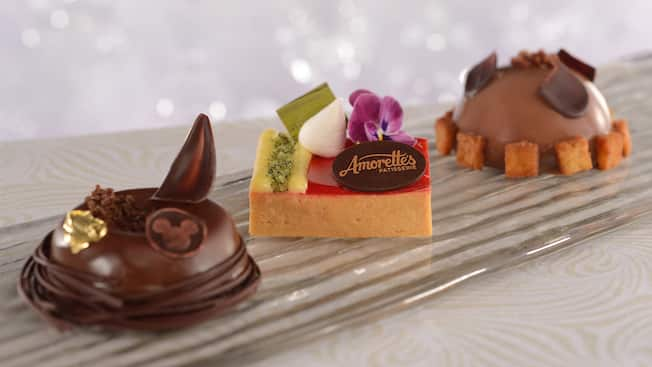 A trio of small, uniquely decorated pastries