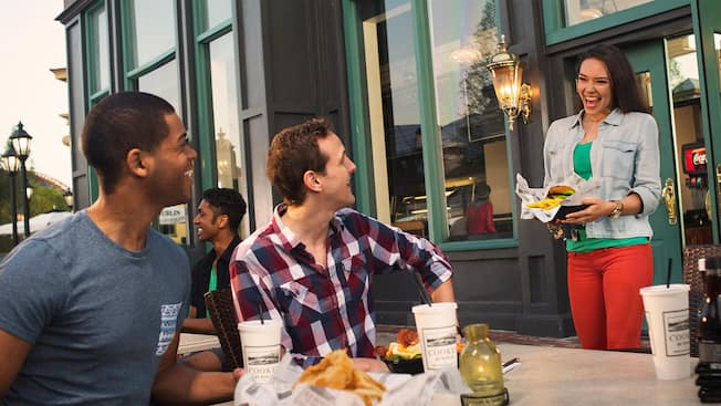 Friends enjoy their meals at an outdoor table at Cookes of Dublin