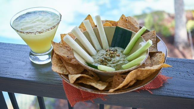 A margarita and sikil pak appetizer