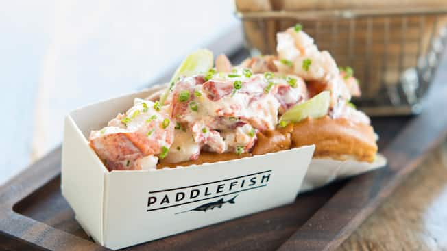 A lobster roll in a Paddlefish logo box