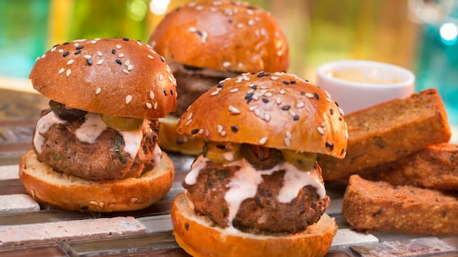 3 lamb sliders with jalapenos and dill sauce next to toast sticks