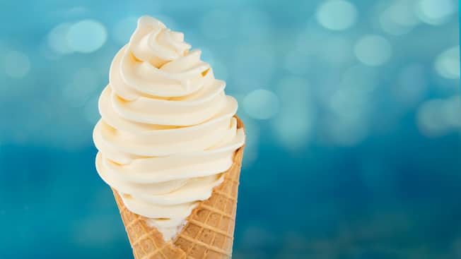A waffle cone with soft serve ice cream