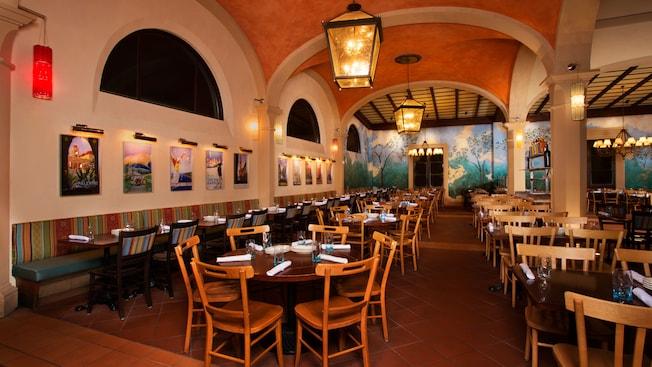 """Fachada del edificio con un letrero que dice """"Pizzeria Ristorante"""" para el restaurante Via Napoli"""