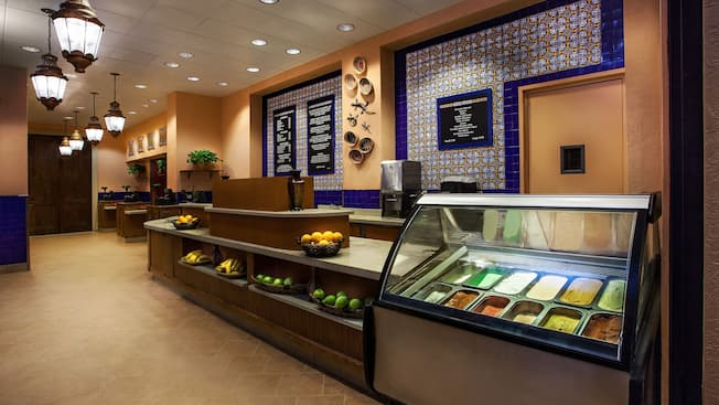 Food counter at Café Rix, a quick service and grab 'n' go restaurant with a Spanish-colonial Mexico design