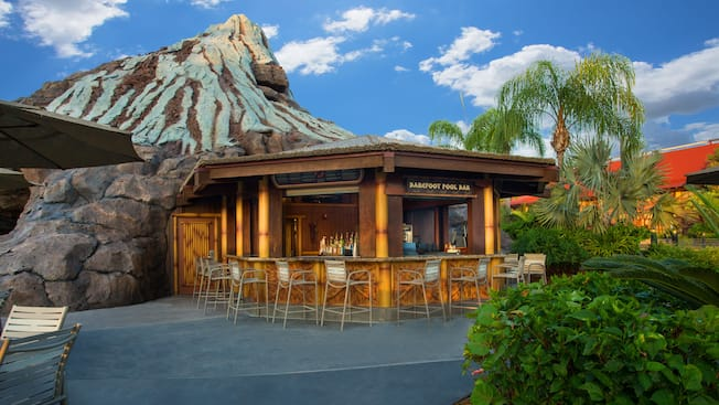 Exterior view of Barefoot Pool Bar at Disney's Polynesian Resort, with Nanea Volcano in the background