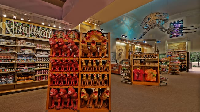 A display of T-Rex dolls inside The Dino Institute Gift Shop at Disney's Animal Kingdom theme park