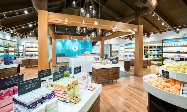 The modern and spacious interior of Basin with organized displays of assorted soaps, bath bombs and body products
