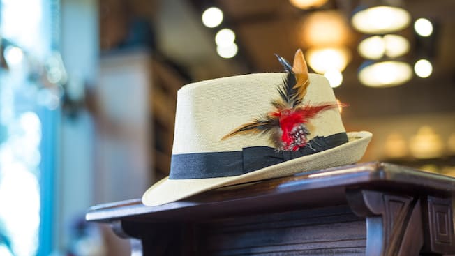 A stylish canvas fedora featuring a feather embellishment and a grosgrain band at Chapel Hats
