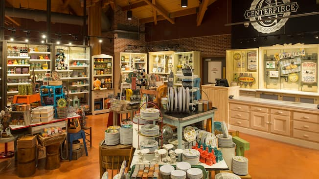 A shop with cabinetry and displays of dinnerware, ceramics, baskets and home furnishings