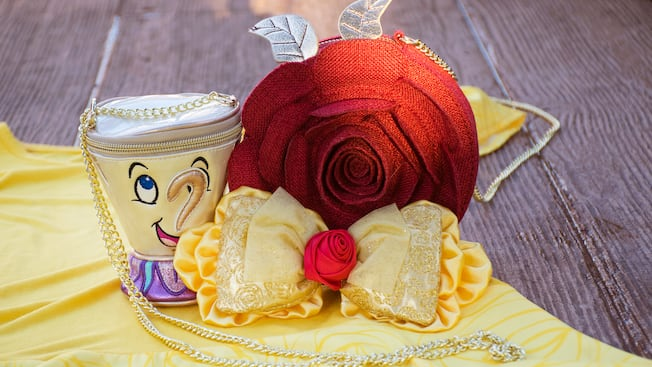 Beauty and the Beast themed crossbody bags featuring Chip the teacup and the enchanted rose with chain straps