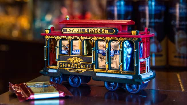 A model San Francisco trolley car holds wrapped squares of Ghirardelli chocolate