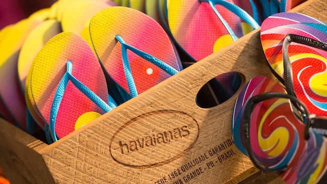 Stacks of vibrant flip flops on display inside a crate within the Havaianas shop at Disney Springs