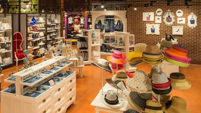 An accessories boutique displays women's hats, jewelry and hand bags