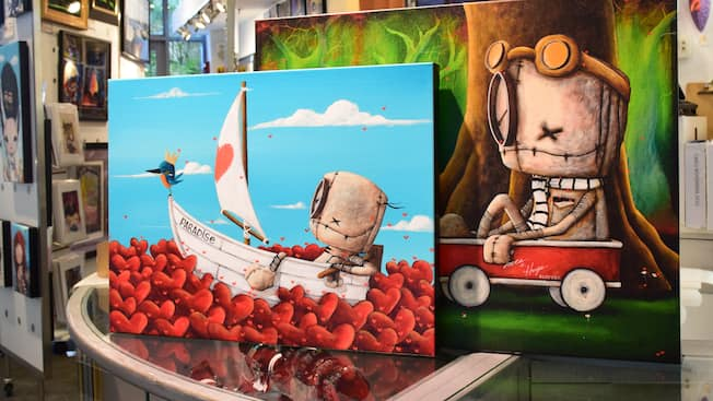 Two canvas art pieces by Dianne Romer-Nomiie on display at Pop Gallery