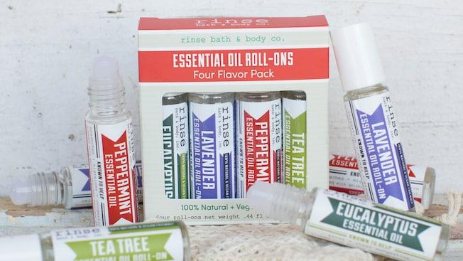 """Contenedores con diversos aceites esenciales cerca de un paquete que dice """"Essential Oil Roll Ons 4 Flavor Pack"""""""