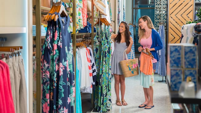 Two young women browse inside the Tommy Bahama boutique
