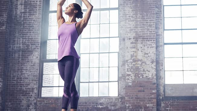 Ballerina Misty Copeland in fifth position wearing Under Armour athletic wear