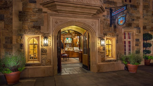 The Crown & Crest shop in the United Kingdom Pavilion at Epcot, lit up at night