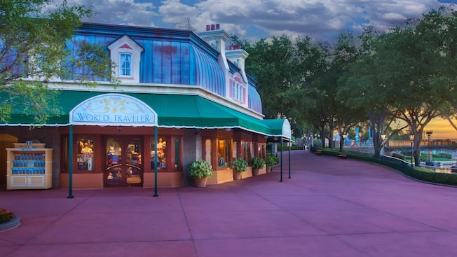 Exterior of the World Traveler shop at Epcot World Showcase at dusk