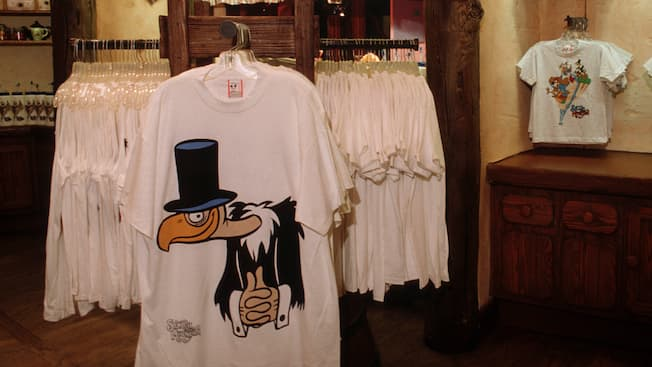 Hanging t-shirts at Briar Patch in Frontierland, featuring a vulture in a top hat