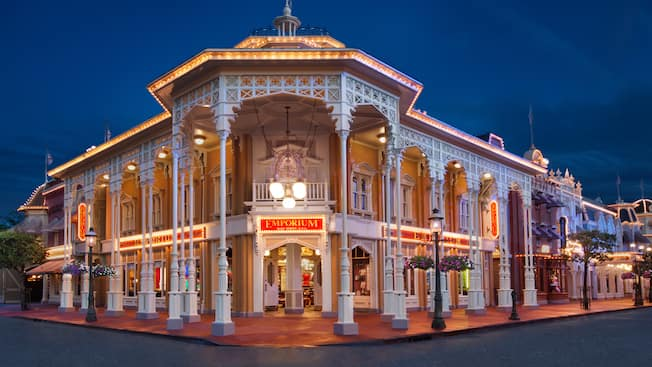 Street view of The Emporium on Main Street, U.S.A. at Magic Kingdom park, lit up at night