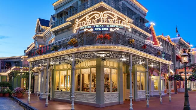 Exterior of Uptown Jewelers on Main Street, U.S.A., lit up in the evening