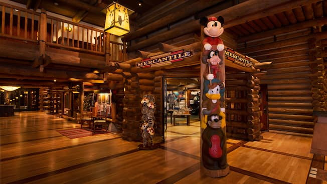 A totem pole of Disney characters at the entrance of Wilderness Lodge Mercantile