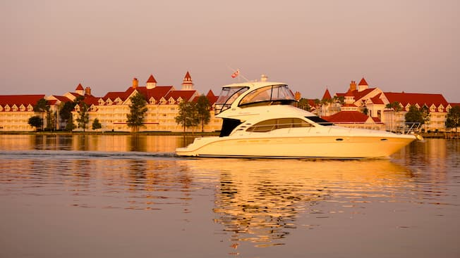 Speedboat cruising the lake past Disney's Grand Floridian Resort & Spa