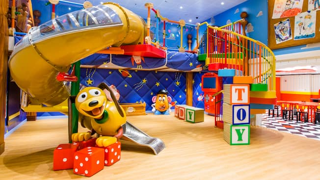 A room themed like the film Toy Story with Mister Potato Head, Slinky Dog and a structure to climb through