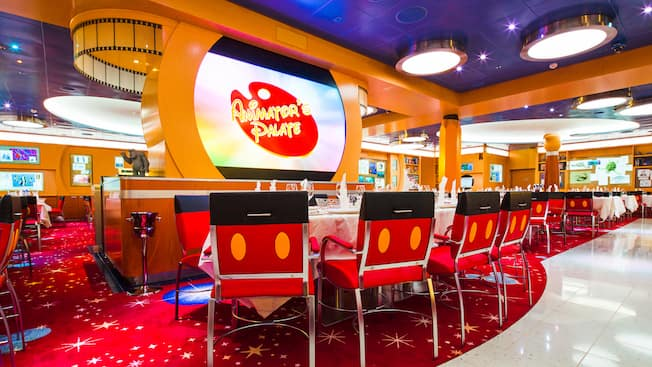 Mickey themed chairs and scenes from popular Disney films adorn the walls at Animators Palate restaurant