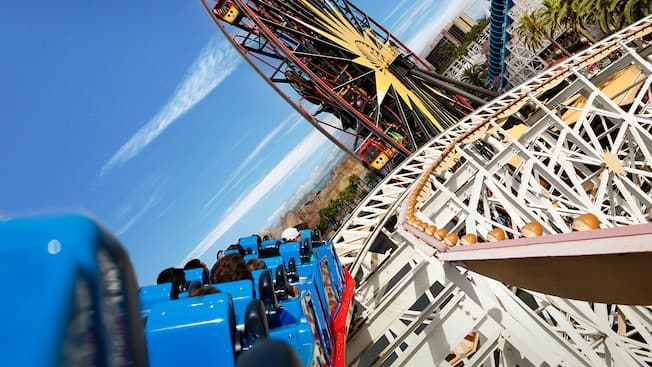 A rollercoaster car speeds around a steep bend at California Screamin' in Paradise Pier