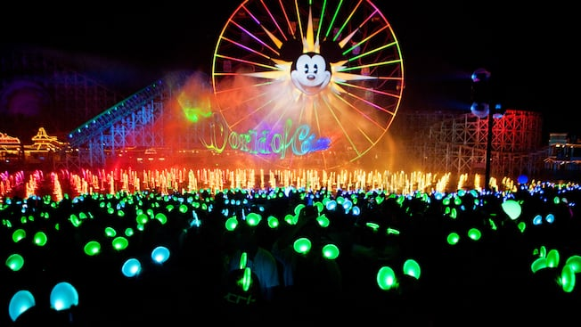Mickey's Fun Wheel with neon lights during the World of Color nighttime spectacular