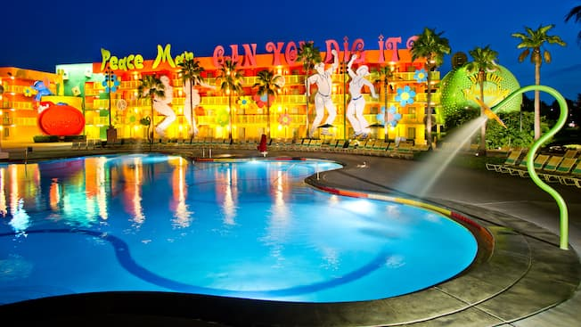 1960s-themed area of Disney's Pop Century Resort, lit up at night