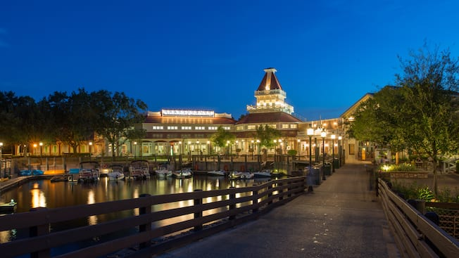 The Sassagoula Steamboat Company building and marina lit up in the evening