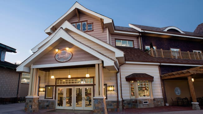 The 2-story building housing Amorette's Patisserie features gingerbread style siding, a roof with 3 sharp-peaked gables and a covered portico with 2 sets of double entry doors