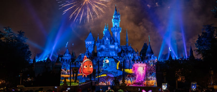 Disneyland official site an elaborate fireworks and light show over sleeping beauty castle with projected images of nemo and ccuart Choice Image
