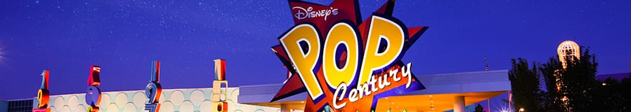 The illuminated exterior of Disney's Pop Century Resort