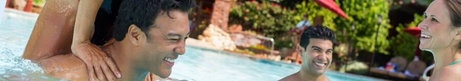 A family enjoys the pool at Disney's Grand Californian Resort