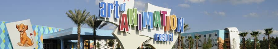 Colorful sign at the entrance to Disney's Art of Animation Resort and a giant painting of young Simba next to it