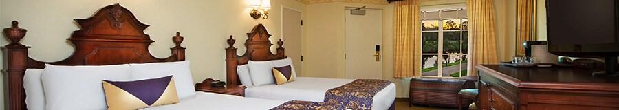 2 queen beds with wooden headboards