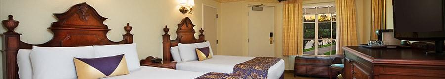2 camas Queen Size con cabeceras de madera