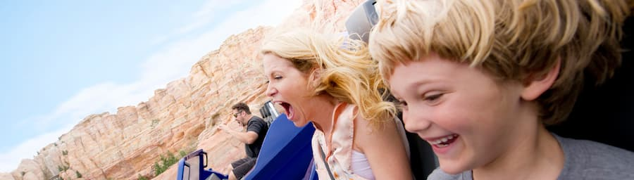 Young boy and his mother enjoying Radiator Springs Racers at Disney California Adventure Park