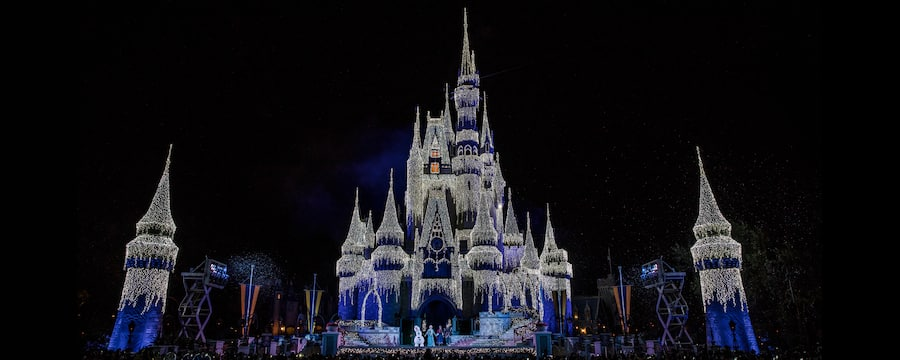 cinderella castle decorated in lights
