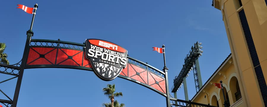 A logo reading ESPN Wide World of Sports Complex is incorporated into an arch above an outdoor entranceway