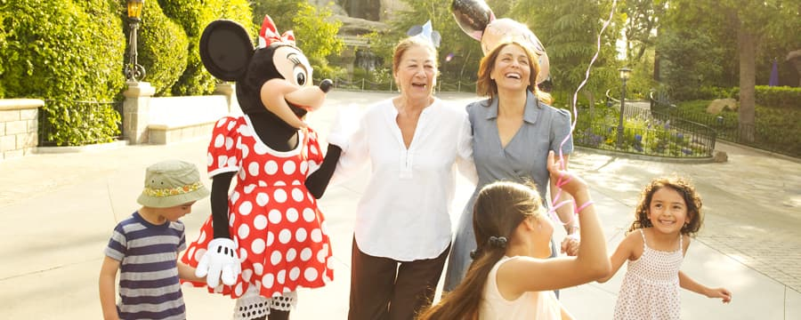 Mickey Mouse and a little girl share a laugh during the girl's birthday party at Disneyland Park