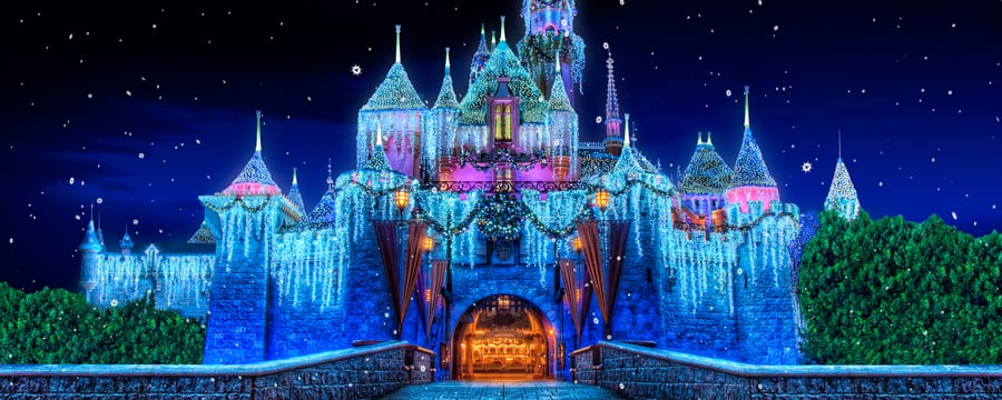Sleeping Beauty Castle decorated with Christmas lights and ornamentation